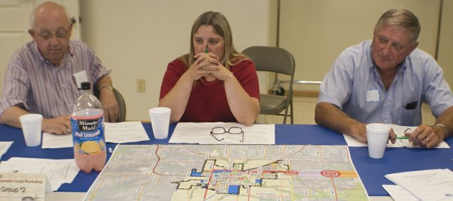 John W. Evans, Paula Crook and Bill New and several other city leaders and business owners attended a public visioning workshop July 16. The workshop was  held by Bucher Willis & Ratliff, the city's planning firm.
