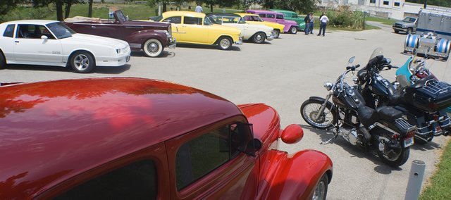 Friends of Ron Starcher brought there reconditioned and customized cars to his funeral Thursday.