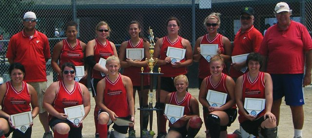 The Tonganoxie Braves 18-and-under team poses with its second-place trophy. Pictured are: (front row) Angela Jacobs, Amanda Albert, Ariel Sanders, Mackenzie Knight, Lindsey Fatherley, Sami Rush, (back row) coach Curtis Smart, Roni Grizzle, Amie Riddle, Katie Rhodes, Melissa Pratt, Ashlee Lohman and coaches Craig Lohman and Pat Albert.