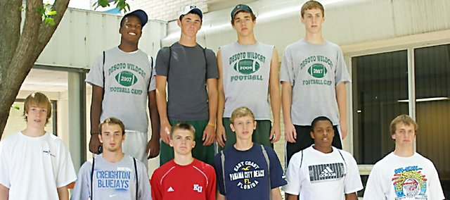 De Soto High basketball players have amassed an 18-13 record this summer while playing in a league, tournaments and team camps. Pictured, from left, in the front row are Aaron Nutterfield, Michael Mello, Mason Wedel, Brandon Philbrook, Jamel Townsend and coach Ryan Wedel. Pictured in the back row are Jeff Bowen, Brendon Hudson, Tommy Elmer and Nick Umholtz. Not pictured are Paul Stallbaumer and Joey Johnson. Other coaches during the season have been Mike Wedel and  John Mello.