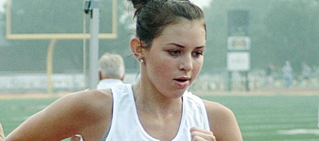 Heather Garcia, right, a 2008 Baldwin High School graduate, runs the final 600 meters of Saturday's 5-kilometer all-star run on the Emporia State University track.