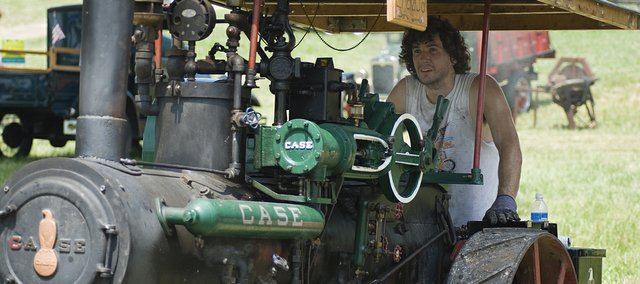 Matt Petty, Meriden, keeps his eyes on the pressure gauge on his half-scale 65 Case steam engine named Ericka Jo. Petty joined several other steam engine and tractor enthusiast in McLouth for the 51st annual Threshing Bee.