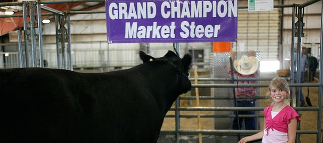 Grace Baxter, 9, of Overbrook, shows off her steer, Chico, Sunday, Aug. 3, 2008 at the Douglas County Fair Livestock Show at the fairgrounds. Baxter was the 2008 grand champion for market steer. She is a fourth grader at Marion Springs Elementary School.