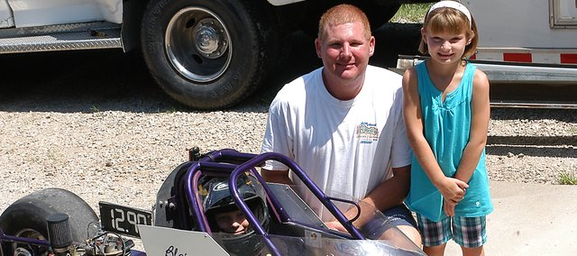 Blaine Miller, seated in dragster, and father Kevin compete in races at Heartland Park in Topeka. Ashley, right, will begin competitive dragster racing during Labor Day weekend.