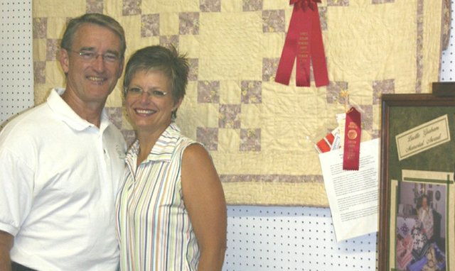 Joe and Kathleen Webb pose with Kathleen's second-place quilt. The Webbs entered the Johnson County Fair for their first time this year.