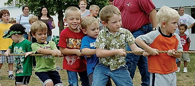 A group of boys pull hard last Friday afternoon in a tug-of-war contest against a group of girls at the Vinland Fair. It was one of many activities for the children that afternoon.