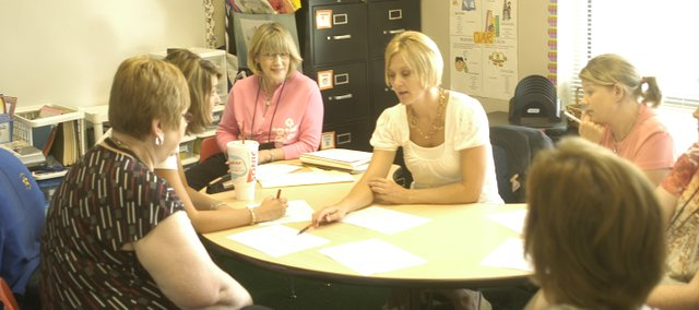 Debbie Taylor, Tana Priddy, Jodi Phillips and Stacey Moore plan Wednesday how they will use their limited space that was built to be a kindergarten classroom at Starside Elementary School.