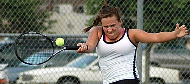 Baldwin High School junior Kaylin McCrary returns a serve at practice Monday afternoon. She is one of many returners on the girls' tennis squad.
