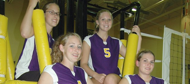 McLouth volleyball seniors (clockwise from top left) Gelia Gardner, Kasey Campbell, Haley Holwick and Amanda Friesz are having fun and working hard for second-year Bulldogs coach Erika Houk.