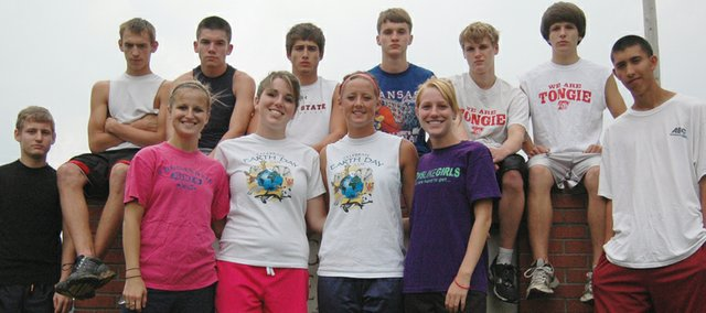 The Tonganoxie High cross country seniors - (front row) Kayla Leffert, Melissa Hughes, Lauren Himpel, Addy Phelps, (back row) Ben Field, Tommy Heskett, Robert Brotherton, Matt Brock, David Powell, Kavet Letourneau, Dalton Lawson and Caleb Iankui - want to improve upon last year, when just two runners went to state.