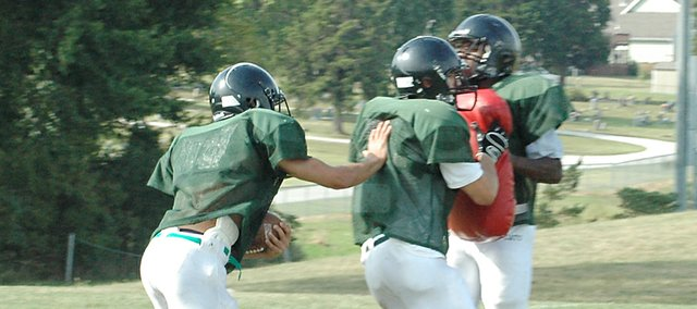 Mark England, left, carries the ball while backfield mate Dylan Burford provides a block during practice Tuesday. The backs played significant minutes at running back on last year's 5-4 team, and figure to be a key part of a young, experienced team in 2008.