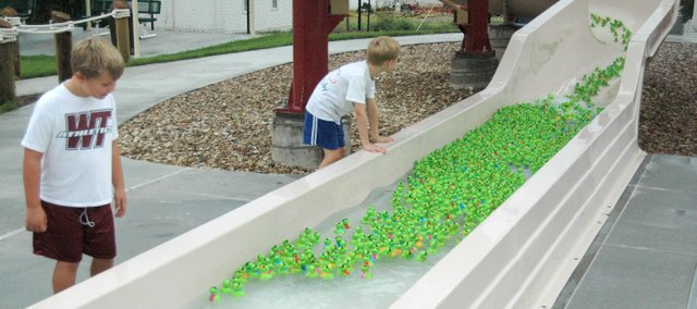 Youths look on in anticipation as plastic turtles come down a slide at Tonganoxie Water Park   on Saturday for the Turbo Turtle Trek. The fundraiser has taken place each year since 2004 and benefits the tiny-K Program of Nurturing Families Inc., in Leavenworth.