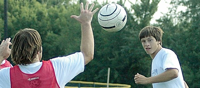 Baldwin High School senior James Simmons, left, blocks a shot from senior Colin Busby during practice. The BHS soccer team opens its season with a home game against Tonganoxie at 4 p.m. Friday.