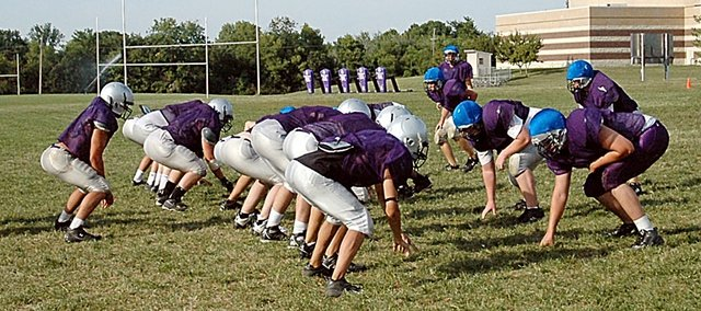 Members of the Baldwin High School football team work on their team offensive and defensive schemes at practice Tuesday. The Bulldogs will scrimmage at 7 p.m. Friday at Liston Stadium. Visitors are asked to bring powdered Gatorade to donate to the team.