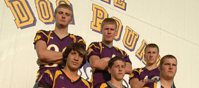 The McLouth High football team, led by seniors (front row) Saul Hernandez, Jarrod Bechard, Josh Overbaugh, (back row) Jake Hullinger, Derrick Crouse and Skyler Terry, wants to make people forget about last season, when the Bulldogs finished with a disappointing record of 1-8.