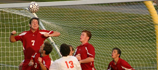 Tonganoxie senior Austin Smith heads the ball away from the Chieftains goal on Tuesday at Bonner Springs. THS fell to the Braves, 5-0.