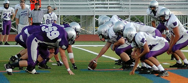 Members of the Baldwin High School varsity team scrimmage Friday night at Baker University's Liston Stadium. Baldwin opens its season at 7 p.m. Friday at Paola.