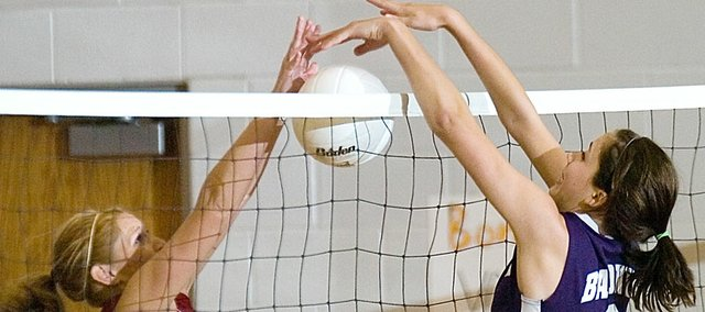 Baldwin High School sophomore Ramie Burkhart, right, blocks a Eudora hitter during one of Tuesday's matches in Bonner Springs.