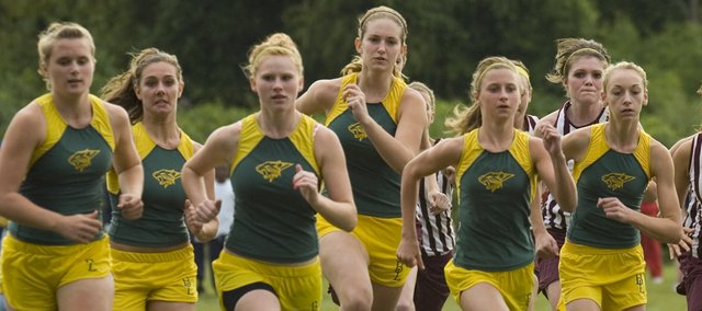 The Basehor-Linwood varsity girls ran away with first place team trophy in the First Annual Bobcats Cross Country Invitational Thursday.  Olympic runner and former congressman  Jim Ryun was on hand to hand out medals.