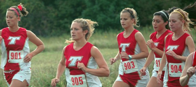 Tonganoxie High girls cross country runners Lauren Himpel, Andie Jeannin, Kayla Leffert, Alex Hauk and Addy Phelps start their 4K race on Thursday against Lansing. The Lions won the duel, but Jeannin finished first.