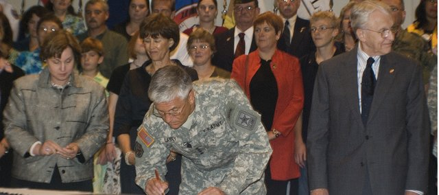 Gen. George Casey Jr., and other community leaders signed the Army Community Covenant during a ceremony held Monday at the Riverfront Community Center in Leavenworth.