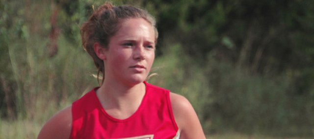 Andie Jeannin won the girls 4-kilometer race for Tonganoxie High on Thursday, but the Chieftains lost their season-opening dual with Lansing.