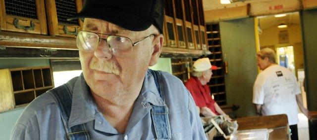 Former engineer with the Chicago-Northwestern Railroad, Bill White, Prairie Village, rides the Midland Railway train  August 30 during the Labor Day Railfest at the Midland Railway in Baldwin City.