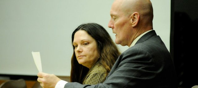 Ramona Morgan sits with her attorney, Billy Rork, of Topeka, on Tuesday just prior to being convicted of two counts of reckless second-degree murder and one count of aggravated battery in the deaths of two KDOT workers and injury of another along U.S. Hwy. 59 south of Lawrence a year ago.