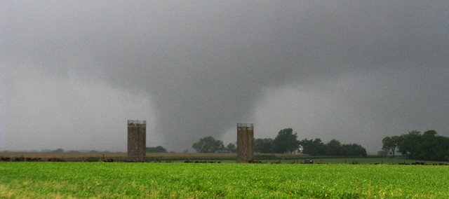 A tornado touches down about one-half mile west of the Douglas-Johnson County line near 458 Road (North 900 Road) looking northwest on Friday. According to the photographer, the tornado rumbled across East 2300 Road just west of the silos.