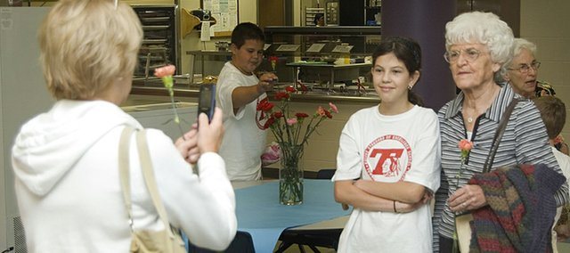 Rachel Elliott, a fifth-grader at Tonganoxie Middle School, poses for a photo with her great-grandmother, Ruth Espy, as Rachel's grandmother, Dot Espy, snaps the photo. Ruth and Dot were visiting Rachel at TMS for Grandparents' Day, which was held for the first time at the middle school. It has been held for years at the elementary school, but this is the first year it was held at the middle school.