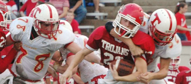 Boomer Carey lowers the boom on an Osawatomie running back during Tonganoxie High's 23-6 defeat of the Trojans on Friday night. The Chieftains' defense was swarming at Osawatomie, holding OHS to 62 yards of total offense.