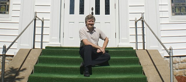 Rev. Jamie Bonnema sits outside First Congregational Church of Tonganoxie.