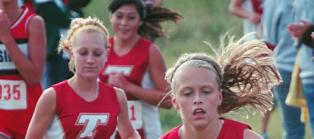 Lauren Hall, Addy Phelps and Alex Hauk all finished in the top 10 on Thursday at the Atchison County Invite. Their efforts, along with the fourth-place finish of Andie Jeannin, helped the Tonganoxie High girls cross country team capture its first team title of the young season.