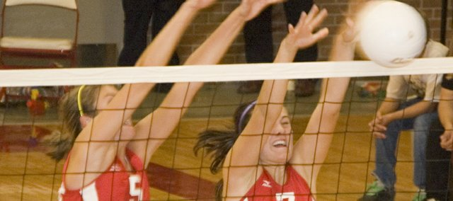 Molly O'Hagan and Megan Puhr go up for a block against Holton on Tuesday, Sept. 9 at Tonganoxie High. The Chieftains won that dual and another the following night at Baldwin.