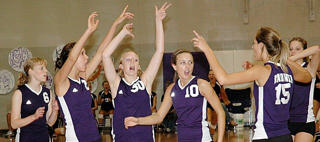 Members of the Baldwin High School volleyball team celebrate winning a point Saturday at the Bulldogs' home tournament. Pictured, from left, are Mallory Sansom, Ramie Burkhart, Taylor Brown, Olivia Catloth, Lyndsey Lober and Katie Brecheisen. Baldwin won two matches Saturday, placing seventh in the tournament.
