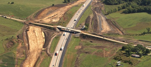 This aerial photo looks east along the Kansas Turnpike at a new interchange being built at Leavenworth County Road 1, the road that crosses the turnpike using a new bridge about eight miles east of Lawrence.