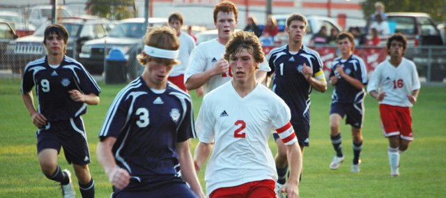 Jamison Bloomer chases Mill Valley's Garrett Vinson on Monday at Chieftain Park. Tonganoxie High lost to MVHS, 4-2, after the Jaguars scored three goals in less than four minutes during the second half.