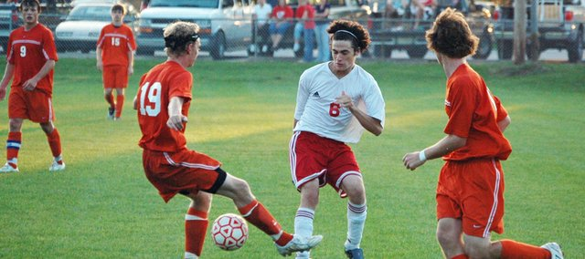Preston Putthoff tries to move the ball through the Bonner Springs defense on Thursday at Chieftain Park. Tonganoxie High lost to BSHS, 2-0.