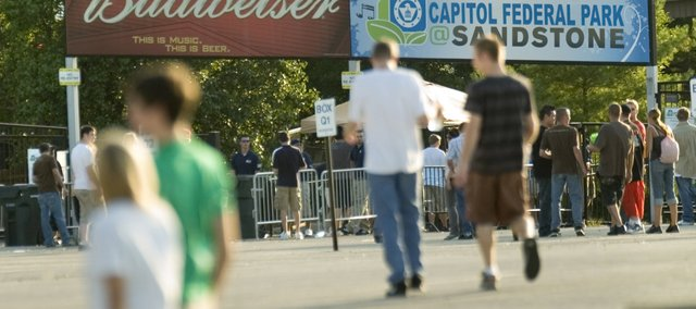 Signs welcome concertgoers to Capitol Federal Sandstone concert park in Bonner Springs. Local police work undercover on site to crack down underage drinking. Those who are caught are issued a citation and escorted out of the concert.