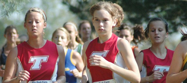 Tonganoxie High runners Lauren Himpel, Sarah Williams and Kayla Leffert run the Rim Rock Farm course on Saturday in Lawrence.