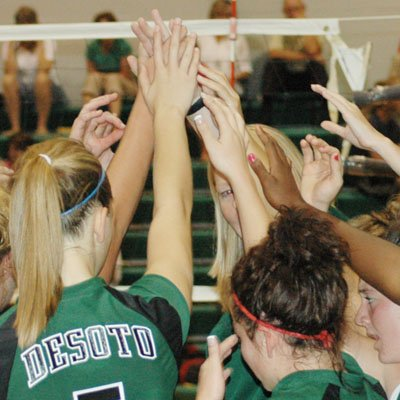 The De Soto volleyball team huddles during a timeout at home last Thursday. The Wildcats are 10-9 on the season and already have twice as many wins as they had all of last year.