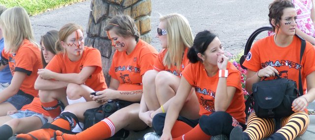 Bonner Springs High School students sit on the curb along Oak Street Friday waiting for the homecoming parade to pass by. From left, the students are: Shelby Ney, Bailey Nairin, Carli Turner, Sylivia Arguda and Meg Fowler.
