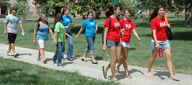 Baker University student walk on campus during the first week of classes in August. Baker has set a record high enrollment this fall as it surpassed 4,000 for its total on all of its campuses.