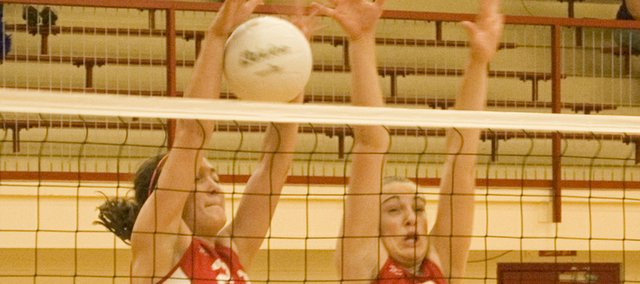 Chrissie Jeannin and Danielle Miller of Tonganoxie High jump for a block in this Mirror file photo.