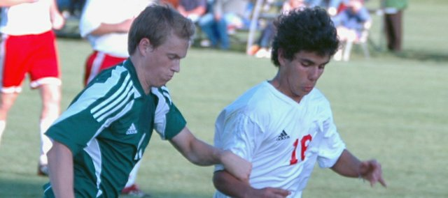 Joao Martins battles a Basehor-Linwood player in this Mirror file photo. Martins scored Tonganoxie's lone goal on Wednesday as the Chieftains picked up their second victory of the season.