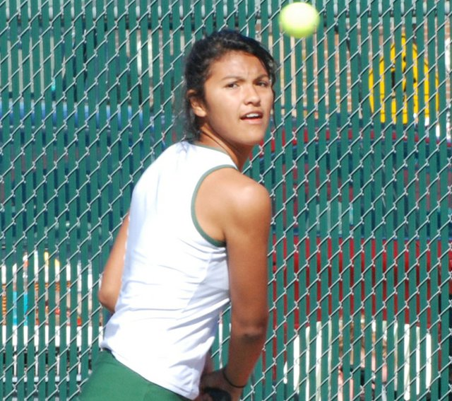 Pearla Jacobo returns a serve last Thursday at Bonner Springs. The Wildcats begin postseason play today.
