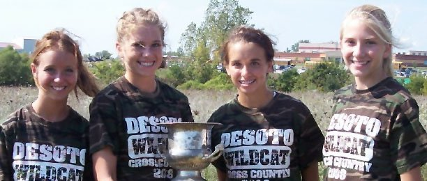 Members of the De Soto girls cross country team pose with their trophy from winning their small class division last weekend at the Metro Invitational. Pictured from left to right are Ellie Sheridan, Beth Reichenberger, Carly Stanley and Lacey Erickson. Runner Hannah Jokisch is not pictured.