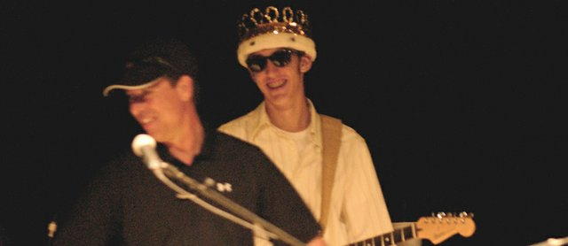 Brian Murdock takes the stage Friday at the De Soto Chamber of Commerce Blues and BBQ contest wearing the crown he received earlier in the evening as the 2009 De Soto High School Homecoming king.