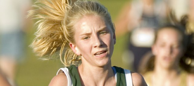 Lacey Erickson runs during Thursday's meet at Shawnee Mission Park. Erickson finished fifth at the race.