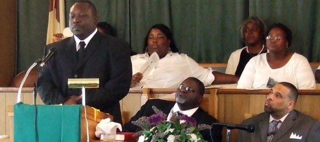 Tyrone Davis delivers his first sermon at Olivet Church of God on Aug. 24. Davis has become a pastor after battling a life of drugs and crime.